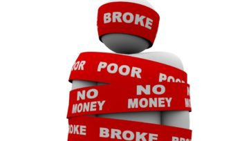 13470962 - a person is wrapped in tape marked with the words broke, poor, and no money, symbolizing being financially strapped an needy due to financial or budget problems, bankruptcy or other cash issue
